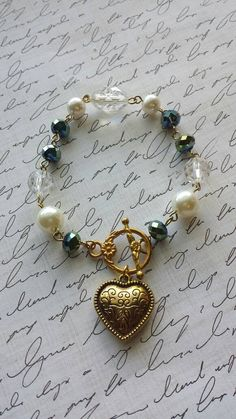 RECEIVE A FREE GIFT WITH ANY PURCHASE ALL WEEK! Ends DEC. 5, 2016 https://www.etsy.com/listing/490168601/crystal-and-pearl-heart-link-bracelet