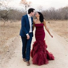 This dress-form fitting on top, fluffy skirt. Love the maroon with the blue suit as well!   Vestidos de novia 2015 Burgundy Mermaid dress.