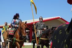 The man on the right, holding the banner, is Duke Henrik of Havn...the first Duke in the SCA, who holds the #1 spot in our Order of Precedence. He became a duke in 1967, after serving as King for the second time...1967...and here he is, on horseback, in armor. He *is* the SCA, and I am privileged to play in this game, that has such people in it.