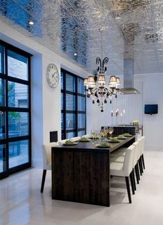 High gloss shine keeps this glam metal embossed dining ceiling modern.