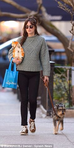 Girl's best friend: Dakota Johnson dresses down to take her delighted pup Zeppelin for a walk in New York City