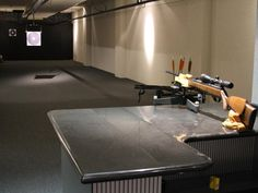 In addition to its more customary functions, this garage also houses a private indoor shooting range.