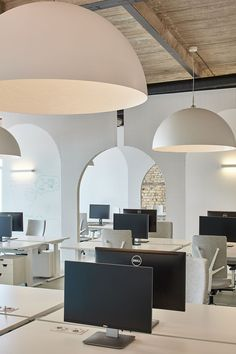 Completed in 2017 in Vilnius, Lithuania. Images by Darius Petrulaitis.COM third office in Vilnius was inspired by Vilnius Old town heritage, where arches, structural elements of the period, formed a special. Corporate Office Design, Open Office Design, Corporate Interiors, Office Interior Design, Office Interiors, Office Designs, Open Space Office, Corporate Offices, Modern Offices