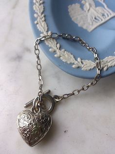 Check out this item in my Etsy shop https://www.etsy.com/listing/233699364/sterling-silver-renaissance-heart
