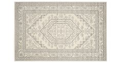 With a beautifully detailed, elegant design in a versatile ivory and silver palette, this power-loomed rug is made of durable polypropylene that is made to withstand the wear of even the most...