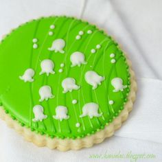 Lily of the Valley cookies - love how the stems are subtle and inlaid.  (Haniela's blog)
