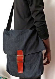 Messenger denim bag with leather fastener/ Holds laptops /raw jeans denim handmade by Wendel Johnston/ lined with wool/ seat belt straps, $78.00