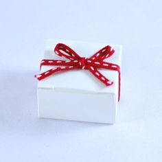 Tiny White Box Red Ribbon