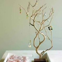 Make a jewelry tree display! Screw the end of a smaller branch into a square, stained piece of wood and adorn it with necklaces, earrings and bracelets.  Makes for a pretty display and a quick jewelry go-to in the morning.