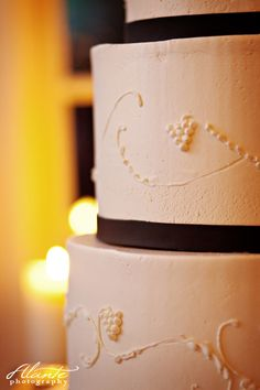 Five tiered wedding cake with wine grape detail by Decadence Cakes