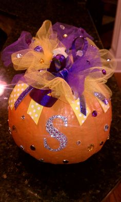 Pumpkin decorated with seqins, ribbon and tulle. Put the initial for the last name.