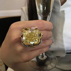 Champagne diamond!! Designed by Anna Hu this fabulous contemporary ring, mounted with a 71 carat fancy intense yellow diamond, is part of her 10 year anniversary exhibition and private sale, on view at Christie's London this weekend and until Tuesday 9 May. Not to be missed!! @christiesjewels @christiesinc @annahu_hautejoaillerie #christiesjewels #christiesinc #christies #annahuhautejoaillerie #diamond #fancycoloureddiamonds #pinkdiamond #ring #tatinger #champagne #exhibition #london