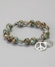 Dial up the style of any ensemble with this stunning accent. A harmony-inspired design with mottled glass beads in the color of earth, sky and sea promises serene glamour and shine in equal measures. World Peace Day, Peace Love And Understanding, Earth Color, Jewelry Design, Jewelry Ideas, Peace And Love, Glass Beads, Aqua, Jewelry Making