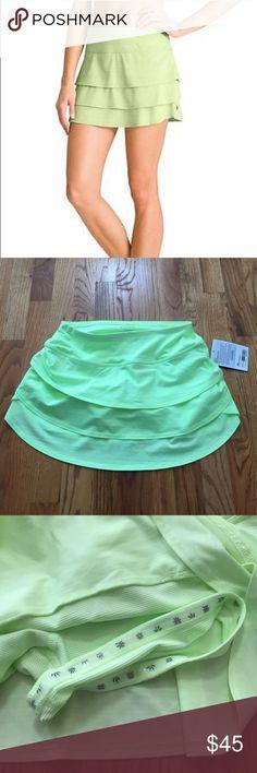 Athleta stripe swagger skort Athleta stripe swagger skort. Size xs. Lime green. NWT Athleta Skirts