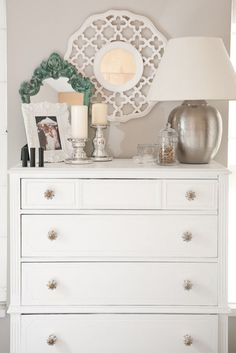the white/silver, the knobs, and the punch of teal. Pretty for C's big girl room someday.love the white/silver, the knobs, and the punch of teal. Pretty for C's big girl room someday. Dresser Top Decor, Chest Of Drawers Decor, Bedroom Dresser Styling, Bedroom Dressers, Bedroom Furniture, Bedroom Decor, Tall Dresser, Dresser Mirror, Mirror Bedroom