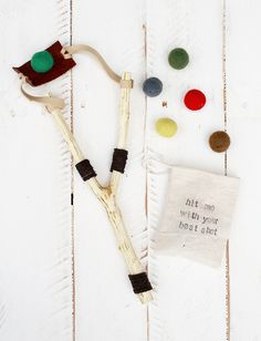 Every Christmas, I like to include at least one handmade (by us) gift for the boys. This year's gift are these fun slingshots! And yes, Levi is in these photos, playing with his gift before Christm...