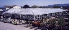 Garden Centres | Bridge Greenhouses Bridge Greenhouses are widely involved in the supply of Garden Centre buildings. Our customers often require more than just a commercial greenhouse which conforms to public occupation regulations; they need a building that will stand out from the competition, with a variety of colours, materials and features. Commercial Greenhouse, Garden Centre, Greenhouse Gardening, Greenhouses, Competition, Buildings, Bridge, Public, Homes