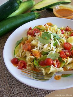 Garden Campanelle Salad with Fresh Tomato Basil Dressing at https://therecipecritic.com  A delicious salad made with all of your summer vegetables!