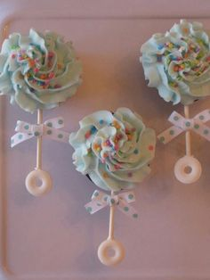 Baby Rattle Cupcakes...these are the BEST Baby Shower Ideas! #christmaspartyideas