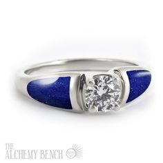 Lapis Lazuli, how we love you! This nontraditional engagement ring features a center diamond with deep blue lapis inlay set into white gold. | The Alchemy Bench #BridalTransformed