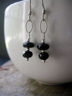 Black watermelon tourmaline is the star of these earrings.  Faceted black watermelon tourmaline rondelles with sterling silver beads hang from sterling silver ovals in these earrings. Simple sterling silver ear wires completes the earrings. The total length of the earrings is 1.75 inches. The earrings would work nicely with this necklace in my shop: https://www.etsy.com/listing/467510099/black-watermelon-tourmaline-necklace  The earrings will arrive gift wrapped because even if it is for…