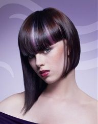 A medium brown straight coloured multi-tonal asymmetrical violet smooth sleek healthy curl hairstyle by Wella