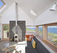 Images by David Barbour. Tinhouse by Rural Design, is located on the northwestern tip of the Isle of Skye, on a steeply sloping site overlooking The Minch, the body of water. Modern Interior Design, Interior Architecture, Building A Small Cabin, Arched Cabin, Contemporary Barn, Modern Barn, Tin House, Rural House, Tiny House Design