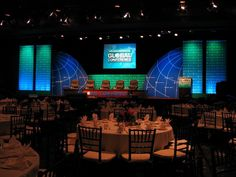 Milken Institute Global Conference Stage #popup #signs with #uplight to cover sides of stage