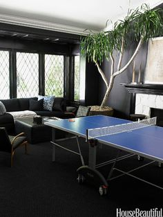 In the game room of Windsor Smith's Los Angeles house, Ralph Lauren's Bone Black  is used in a flat finish on the walls and in high gloss on the trim.