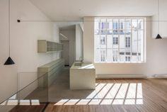 Rue de Condé Duplex Apartment is a minimal apartment located in Paris, France, designed byciguë