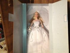 Brand: BarbieColor: Multi-coloredFeatures: PLEASE READ PRODUCT DESCRIPTION FOR SHIPPING INFORMATION 1995 Collectors Barbie Blushing Bride 12 Inch Special Edition Barbie Doll With bridal Gound and Vail New in Factory Packaging Binding: ToyPublisher: MattelDetails: Blushing Bride Barbie wears a white gown adorned with white roses and ribbons, a pearl necklace, and a bridal veil.UPC: 074299260742EAN: 0782361092435Package Dimensions: 13.8 x 8.1 x 2.6 inchesLanguages: English Belle Wedding Dresses, Bride Dolls, White Gowns, Barbie Collector, Ribbons, Pearl Necklace, Artsy, Product Description, Blush