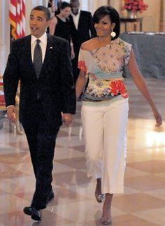 Don't Be Afraid of Wide-Leg Capris  Michelle Obama dazzled onlookers with a Basso & Brooke off-the-shoulder top, white pants and silver heels at the White House's poetry jam that President Obama hosted.     You might be hesitant to wear wide-leg capris, like Mrs. O—some say they make you look wider and shorter—but worn the right way (with heels and a pretty, print top), you won't disappoint.     Try the Legacy Wide-Leg Crop Pants (above, 88$ at WhiteHouseBlackMarket.com).