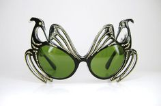 Vintage and very rare pair of French cats eye glasses with brilliant Aurora rhinestones and Phoenix design.