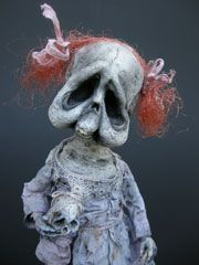 Very creepy doll, but at the same time there is something so sweet and vulnerable - I just want to give her a hug.