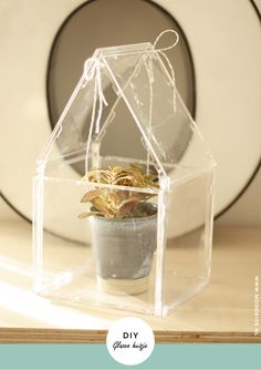 upcycling cd's become glass house #DIY #recycle www.moodkids.nl