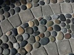 river rock and pavers wet-laid in concrete - easy to maintain and durable