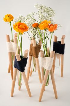 French designer Aurélie Richard created these vases from simple wood pieces woven together with yarn. So crafty!