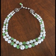 Green and White Double Strand pearl/bead necklace. Double-strand faux pearls interspaced with green faceted plastic beads, with silvertone hardware. Jewelry Necklaces