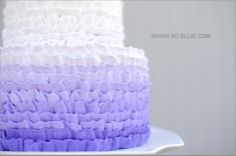 purple ombre wedding cake...maybe not in purple, but I love the way they iced with butter cream icing instead of that nasty fondant...really pretty! :)