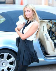 Pin for Later: Can't-Miss Celebrity Pics!  Paris Hilton went shopping with her puppy in LA on Tuesday.