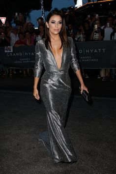 Pin for Later: These Latinas Impressed at Cannes With Their Gorgeous Style Eva Longoria Metallic, skintight, three-quarter sleeves, and a plunging neckline — Eva was pure perfection.