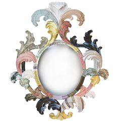 http://www.squintlimited.com/products/the_carved_oval_leaf_mirror//  Wow, I have a few old mirrors that look like this but gold, I could paint!!