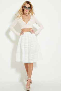 A semi-sheer woven A-line skirt with grid-cutout panels, pleated accents along the waist, and a concealed back zipper.