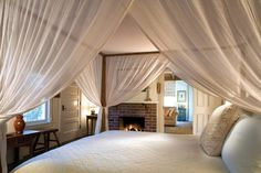 Love the bed and fireplace!