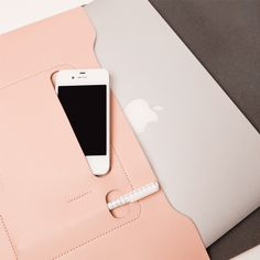 Minimalist Folio Blush - Large $48 Arrive in style to your next meeting. This minimalist carrier neatly holds documents and features an inside pouch that is just right for the little things – phone, cards, a pen. The Medium folio comfortably fits a tablet and go-to notebook, and the Large will fit a laptop up to 13 inches. Both fold closed with a coverlet that is secured by two peg-in-hole fastenings. Choose between Blush, Navy and glossy Pewter.
