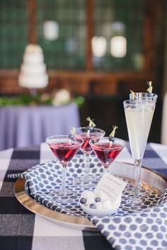 blueberry inspired signature drink + tray with a fun linen