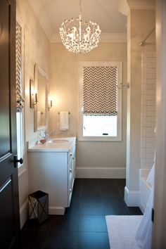 chevron roman shade and great light fixture update this small bath