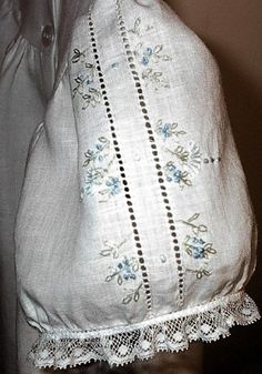 Close-up view of the sleeve for the heirloom dress. Hand stitched drawn work and delicate embroidery on fine linen.