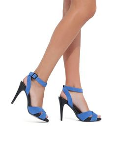 An ultra high heel, soft suede and an ankle strap play up the flirty vibe.