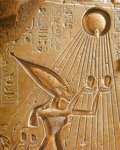King Akhenaten and his wife Nefertiti praying to the sun-god Aten who provided his rays to the king and the queen. The sun rays end up with hands holding the key of life offering it to the royal family.  Akhenaten and Nefertiti changed Egypt's official religion to devotion to Aten, angering many powerful priests of the traditional multi-god religion. The sun-disk, during the Amarna period usually depicted with sun rays ending in hands that offer the sign of life (ankh) to the king and his f